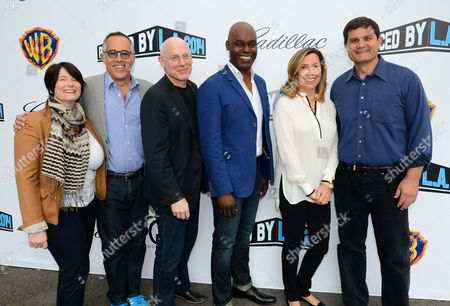 From left, Jessica Lacy, John Cooper, Joshua Astrachan, Cameron Bailey, Leslee Dart, and Jason Constantine arrive at the 2014 Produced By Conference - Day 1 at Warner Bros. Studios, in Burbank, Calif