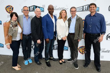 From left, Jessica Lacy, John Cooper, Joshua Astrachan, Cameron Bailey, Leslee Dart, Peter Saraf and Jason Constantine arrive at the 2014 Produced By Conference - Day 1 at Warner Bros. Studios, in Burbank, Calif