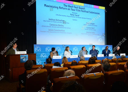 From left, Peter Saraf, Jessica Lacy, Leslee Dart, John Cooper, Jason Constantine, Cameron Bailey, and Joshua Astrachan seen during The Best Fest Quest: Maximizing Returns on Your Film Festival Submission panel sponsored by Landmark Theatres at the 2014 Produced By Conference - Day 1 at Warner Bros. Studios, in Burbank, Calif