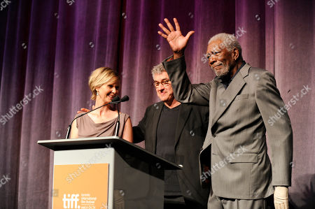 """Cynthia Nixon, and from left, Richard Loncraine and Morgan Freeman acknowledge the crowd at the premiere of """"Ruth & Alex"""" on day 2 of the Toronto International Film Festival at the Princess of Wales Theatre, in Toronto"""