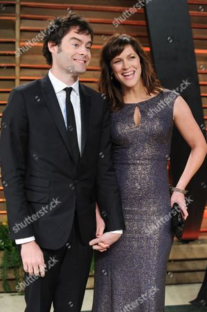 Bill Hader and wife Maggie Carey attend the 2014 Vanity Fair Oscar Party,, in West Hollywood, Calif