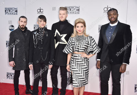 Avi Kaplan, from left, Mitch Grassi, Scott Hoying, Kirstie Maldonado, and Kevin Olusola of Pentatonix arrive at the American Music Awards at the Microsoft Theater, in Los Angeles