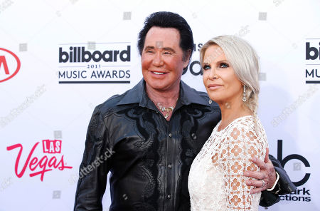 Wayne Newton, left, and Kathleen McCrone arrive at the Billboard Music Awards at the MGM Grand Garden Arena, in Las Vegas