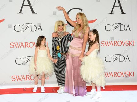Betsey Johnson and Lulu Johnson with her daughters arrive at the 2015 CFDA Fashion Awards at Alice Tully Hall, in New York