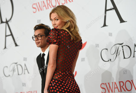 Stock Image of Model Karlie Kloss and Artistic Director of DVF Michael Herz arrive at the 2015 CFDA Fashion Awards at Alice Tully Hall, in New York