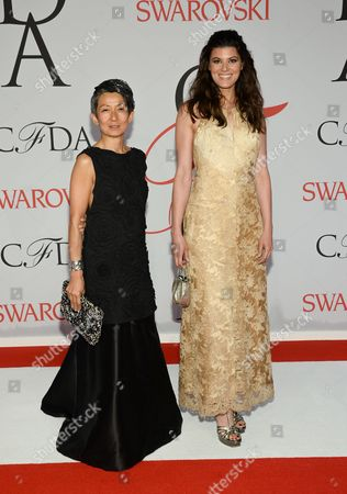 Jussara Lee, left, Summer Rayne Oakes arrive at the 2015 CFDA Fashion Awards at Alice Tully Hall, in New York