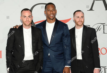 Ariel Ovadia, left, Victor Cruz and Shimon Ovadia arrive at the 2015 CFDA Fashion Awards at Alice Tully Hall, in New York