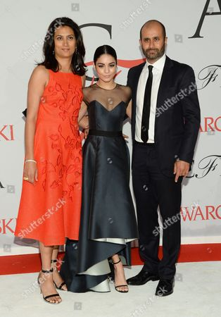 Stock Image of Sachin Ahluwalia, Vanessa Hudgens, and Babi Ahluwalia arrive at the 2015 CFDA Fashion Awards at Alice Tully Hall, in New York