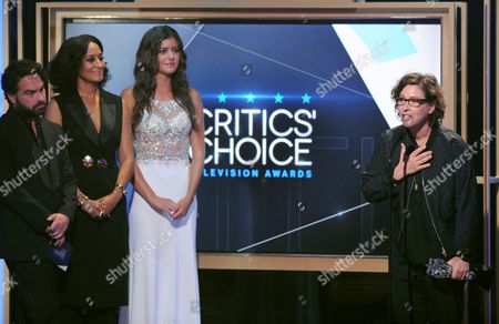 Lisa Cholodenko accepts the award for best limited series for Olive Kitteridge at the Critics' Choice Television Awards at the Beverly Hilton hotel, in Beverly Hills, Calif. Looking on from left are Johnny Galecki, and Tracee Ellis Ross