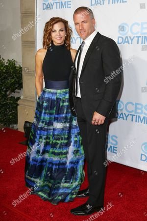 Gina Tognoni, left, and Sean Carrigan arrive at the 2015 Daytime Emmy Awards CBS After Party at The Hollywood Athletic Club, in Los Angeles