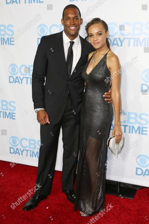 Lawrence Saint-Victor, left, and Reign Edwards arrive at the 2015 Daytime Emmy Awards CBS After Party at The Hollywood Athletic Club, in Los Angeles