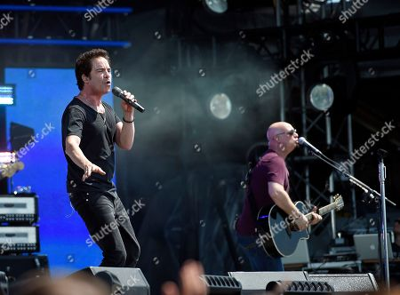 Pat Monahan, left, and Jimmy Stafford, right, of Train perform at the Global Citizen 2015 Earth Day on the National Mall, in Washington