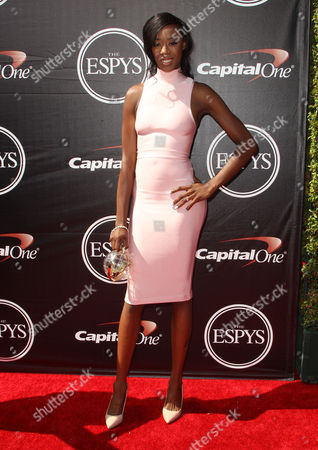Volleyball player Destinee Hooker arrives at the ESPY Awards at the Microsoft Theater, in Los Angeles
