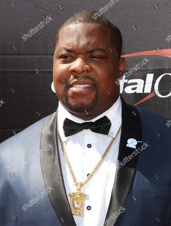 NFL player Terrance Knighton, of the Washington Redskins, arrives at the ESPY Awards at the Microsoft Theater, in Los Angeles