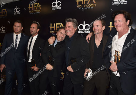 """Channing Tatum, from left, Walton Goggins, Tim Roth, Kurt Russell, James Parks and Michael Madsen, winners of the Hollywood ensemble award for """"The Hateful Eight,"""" pose in the press room at the Hollywood Film Awards at the Beverly Hilton Hotel, in Beverly Hills, Calif"""
