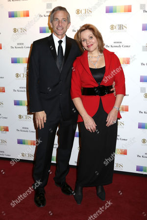 Renee Fleming, right, and husband Tim Jessell attend the 38th Annual Kennedy Center Honors at The Kennedy Center Hall of States, in Washington