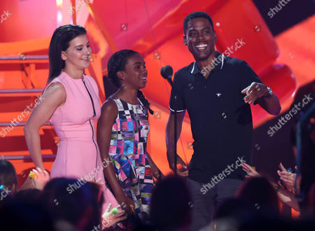 Stock Image of Katherine Herzer, left, and Chris Rock present the award for favorite family TV show at Nickelodeon's 28th annual Kids' Choice Awards at The Forum, in Inglewood, Calif
