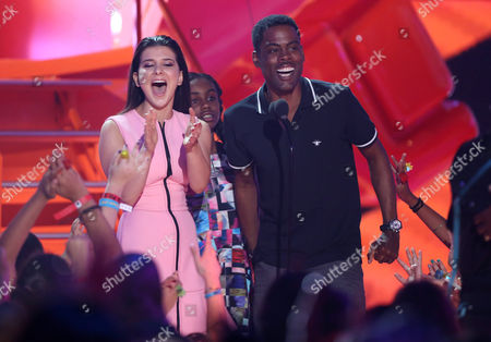 Stock Photo of Katherine Herzer, left, and Chris Rock present the award for favorite family TV show at Nickelodeon's 28th annual Kids' Choice Awards at The Forum, in Inglewood, Calif