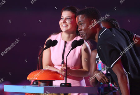 Katherine Herzer, left, and Chris Rock present the award for favorite family TV show at Nickelodeon's 28th annual Kids' Choice Awards at The Forum, in Inglewood, Calif