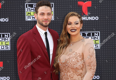 Gabriel Coronel, left, and Chiquis Rivera arrive at the Latin American Music Awards at the Dolby Theatre, in Los Angeles