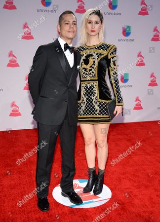 Pablo Gonzalez, left, and Francisca Valenzuela arrive at the 16th annual Latin Grammy Awards at the MGM Grand Garden Arena, in Las Vegas