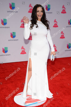 Julie Ferretti arrives at the 16th annual Latin Grammy Awards at the MGM Grand Garden Arena, in Las Vegas