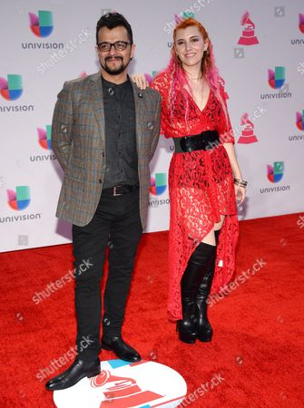 """Jorge """"Chiquis"""" Amaro, left, and Maria Barracuda, of Jotdog, arrive at the 16th annual Latin Grammy Awards at the MGM Grand Garden Arena, in Las Vegas"""