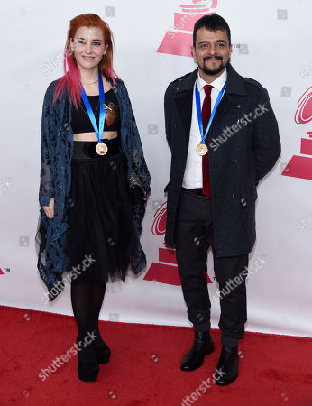 """Maria Barracuda, left, and Jorge """"Chiquis"""" Amaro, of the musical group Jotdog, nominated for best rock song for Celebracion, arrive at the Latin Recording Academy Person of the Year Tribute honoring Roberto Carlos at the Mandalay Bay Convention Center, in Las Vegas"""