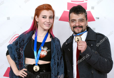 """Stock Image of Maria Barracuda, left, and Jorge """"Chiquis"""" Amaro, of the musical group Jotdog, nominated for best rock song for Celebracion, arrive at the Latin Recording Academy Person of the Year Tribute honoring Roberto Carlos at the Mandalay Bay Convention Center, in Las Vegas"""