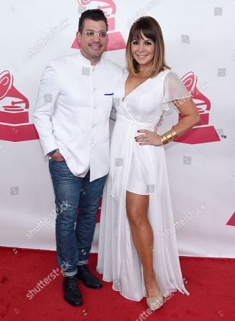 Rafael Brito, left, and Ana Maria Simon arrive at the Latin Recording Academy Person of the Year Tribute honoring Roberto Carlos at the Mandalay Bay Convention Center, in Las Vegas