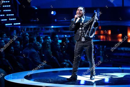 "Stock Photo of Espinoza Paz performs ""Perdi La Pose"" at the 16th annual Latin Grammy Awards at the MGM Grand Garden Arena, in Las Vegas"