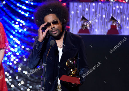 "Alex Cuba accepts the award for best singer songwriter album for ""Healer"" at the 16th annual Latin Grammy Awards, in Las Vegas"
