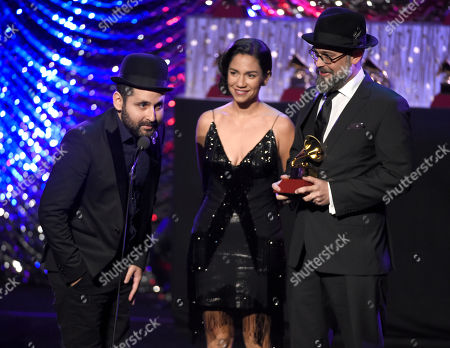 """Visitante, of Calle 13, from left, Kacho Lopez and Tristana Robles accept the award for best short form music video for """"Ojos Color Sol"""" by Calle 13 at the 16th annual Latin Grammy Awards, in Las Vegas"""