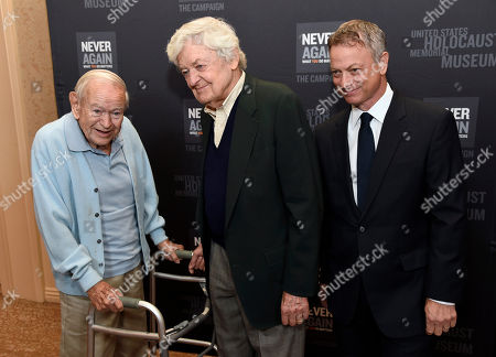 Daniel Gillespie, from left, Hal Holbrook and Gary Sinise arrive at the Los Angeles Dinner : What You Do Matters at the Beverly Hilton Hotel, in Beverly Hills, Calif