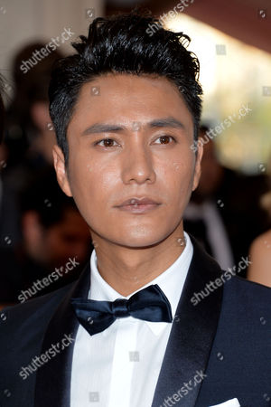 "Chen Kun arrives at The Metropolitan Museum of Art's Costume Institute benefit gala celebrating ""China: Through the Looking Glass"", in New York"