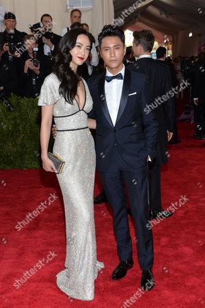 "Tang Wei, left, and Chen Kun arrive at The Metropolitan Museum of Art's Costume Institute benefit gala celebrating ""China: Through the Looking Glass"", in New York"