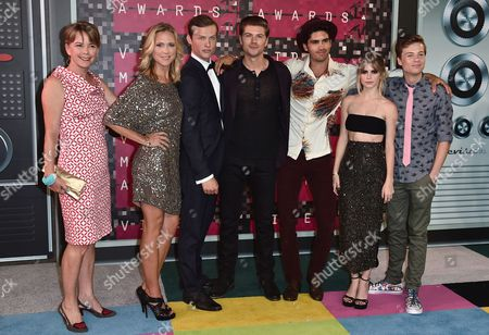 Jill E. Blotevogel, from left, Tracy Middendorf, Connor Weil, Amadeus Serafini, Tom Maden, Carlson Young, and John Karna arrive at the MTV Video Music Awards at the Microsoft Theater, in Los Angeles