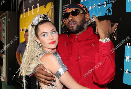 Miley Cyrus, left, and Mike Will Made It arrive at the MTV Video Music Awards at the Microsoft Theater, in Los Angeles