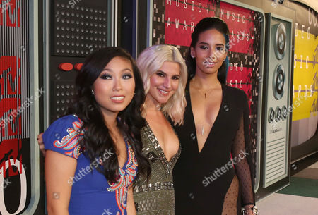 TV personalities Awkwafina, from left, Carly Aquilino and Nessa Diab arrive at the MTV Video Music Awards at the Microsoft Theater, in Los Angeles