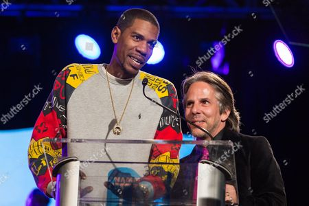 Stock Picture of Young Guru, left, and Dave Reitzas speak on stage during the 2015 National Association of Music Merchants