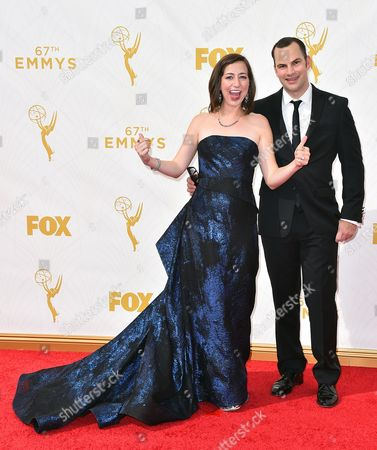 Kristen Schaal, left, and Rich Blomquist arrive at the 67th Primetime Emmy Awards, at the Microsoft Theater in Los Angeles