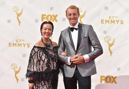 Sue Wong, left, and Prince Mario-Max Schaumburg-Lippe arrive at the 67th Primetime Emmy Awards, at the Microsoft Theater in Los Angeles