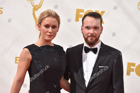 Katie Cassidy, left, and Dana Brunetti arrive at the 67th Primetime Emmy Awards, at the Microsoft Theater in Los Angeles