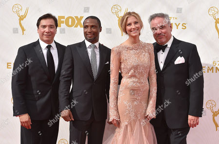 Benito Martinez, from left, Elvis Nolasco, Caitlin Gerard and W. Earl Brown arrive at the 67th Primetime Emmy Awards, at the Microsoft Theater in Los Angeles