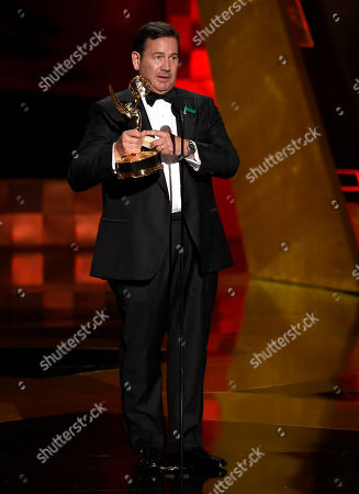 David Nutter accepts the award for Outstanding Director for Game Of Thrones at the 67th Primetime Emmy Awards, at the Microsoft Theater in Los Angeles