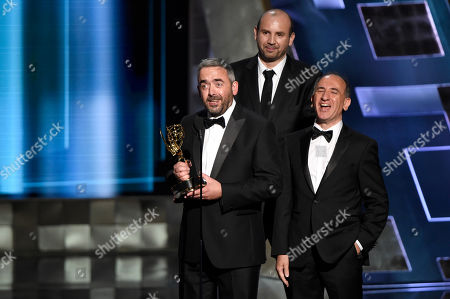 Simon Blackwell, from left, Tony Roche, and Amando Ianucci accept the award for outstanding writing for a comedy series for Veep Election Night at the 67th Primetime Emmy Awards, at the Microsoft Theater in Los Angeles