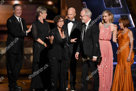 "Francis McDormand, left, Lisa Cholodenko, Gary Goetzman and the cast of ""Olive Kitteridge"" accept the award for outstanding limited series for Olive Kitteridge at the 67th Primetime Emmy Awards, at the Microsoft Theater in Los Angeles"