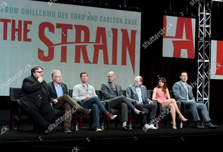 "Guillermo del Toro, co-creator/executive producer/writer, from left, Carlton Cuse, showrunner/executive producer/writer, Chuck Hogan, co-creator/executive producer/writer, Corey Stoll, David Bradley, Mia Maestro and Kevin Durand participate in ""The Strain"" panel at the FX Summer TCA Tour at the Beverly Hilton Hotel, in Beverly Hills, Calif"