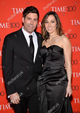 Immagine stock a tema Computational Biologist Paradis Sabeti, right, and husband John Rinn attend the TIME 100 Gala, celebrating the 100 most influential people in the world, at the Frederick P. Rose Hall, Time Warner Center, in New York