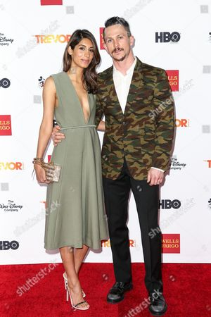 Stock Picture of Jonathan Tucker, right, and Tara Ahamed Tucker attend 2015 TrevorLIVE LA held at the Hollywood Palladium, in Los Angeles